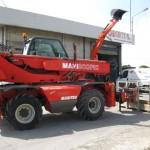 Rentiranje mašina | Telehendler Manitou MRT 1432 | mašina u radu, podignut kran